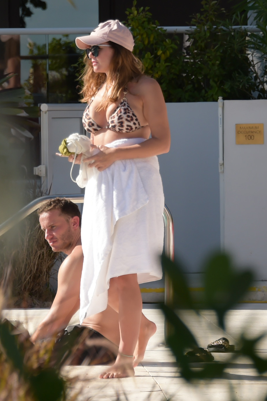 Imogen Thomas shows off her cleavage as she hits the pool in Miami 11/18/17